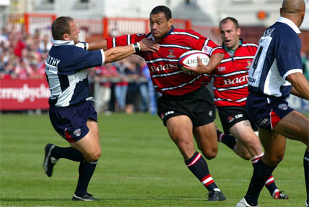 Zurich Premiership - Gloucester RFC v Bristol Shoguns @ Kingsholm, Gloucester - 21/9/2002 - Gloucester's  Junior Paramore (right) is tackled by Bristol's Neil McCarthy. ©2002 GPA Images E-mail: info@gpaimages.com www.gpaimages.com